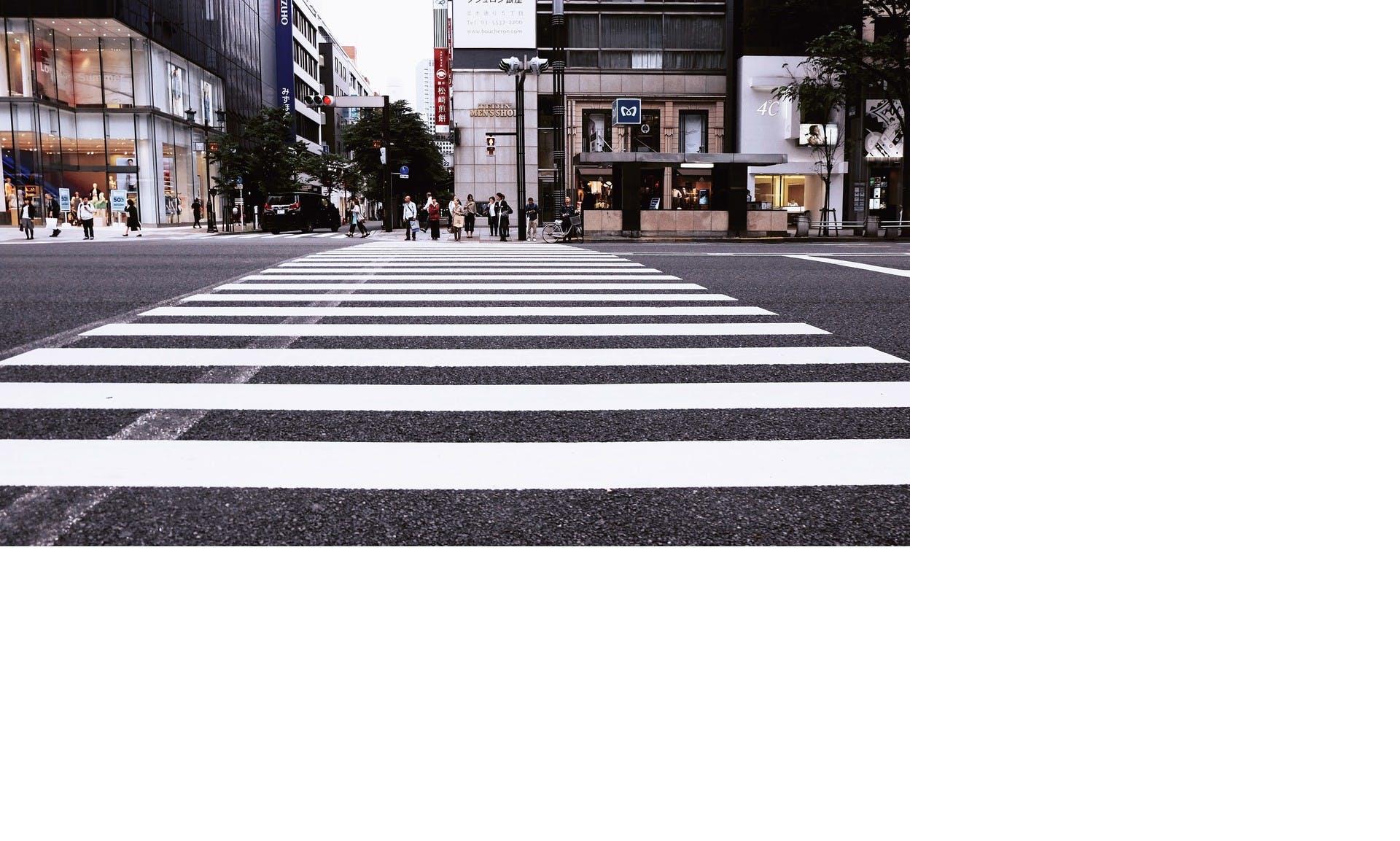 A pedestrian crossing in a big city